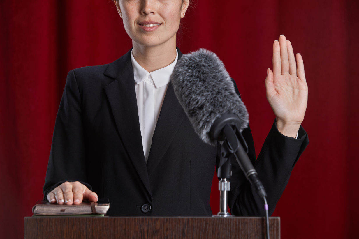 Witness giving oath to tell the truth in court case.