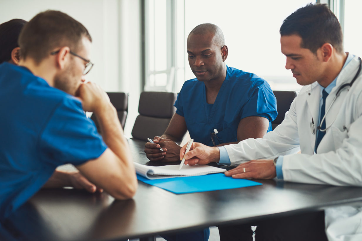 Young medical professionals and lawyer look into personal injury cases